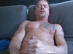 He strokes and strokes and shoots out a HUGE load